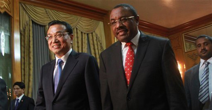 Chinese Premier Li Keqiang, left, is welcomed by Ethiopian Premier Hailemariam Desalegn at the Ethiopian Presidential Palace, in Addis Ababa, Ethiopia, Sunday May 4, 2014. Chinese Premier Li Keqiang has started his four-country tour of Africa with calls for deepening of ties between China and Africa. Li arrived in the Ethiopian capital of Addis Ababa Sunday and met with Ethiopian Premier Hailemariam Desalegn and signed a raft of trade agreements. ELIAS ASMARE — AP Photo