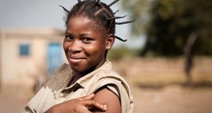 Edwinge Nana, 19, after vaccination in the village of Koubri, Burkina Faso. Edwinge's little brother Charles died of meningitis at age 7